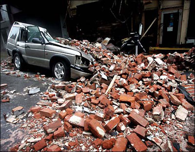 A car crushed by bricks