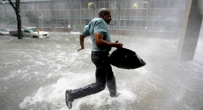 A Hurricane Katrina survivor runs to safety